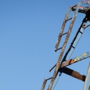 a broken ladder on industrial equipment