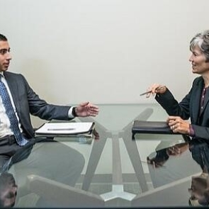 two people discussing business at a table