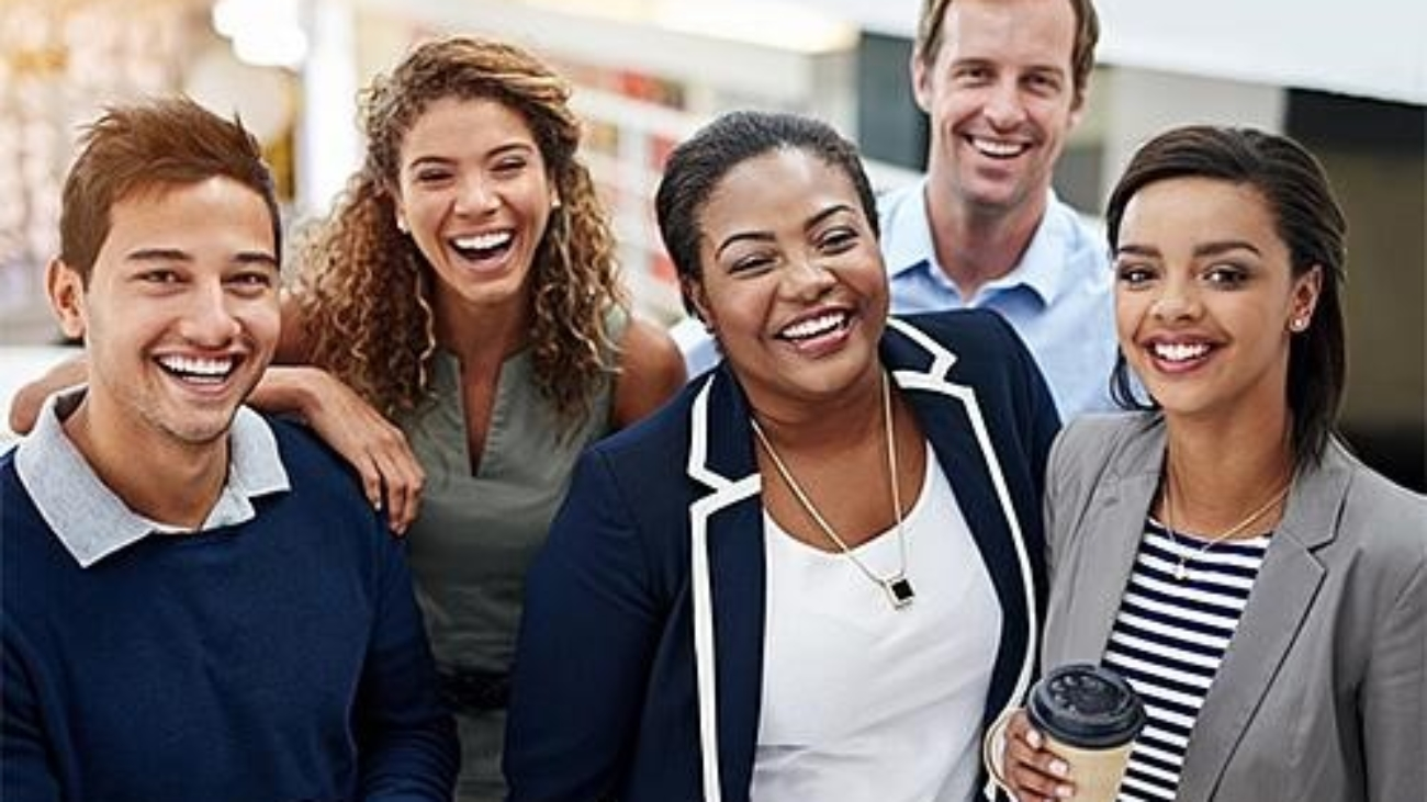 Five professional people smiling both male and female